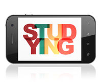 Learning concept: Smartphone with Studying on  display