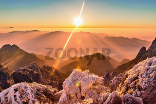 Sunrise above mountain peaks.