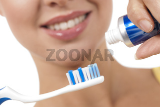 A close up of a beautiful woman with toothbrush
