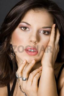 portrait of pretty girl on black