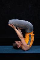 Woman doing Ashtanga Vinyasa Yoga asana Urdhva padmasana