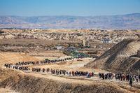 Tourists and pilgrims walk after visiting the Jordan River