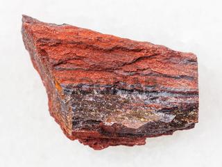 rough ferruginous quartzite stone on dark