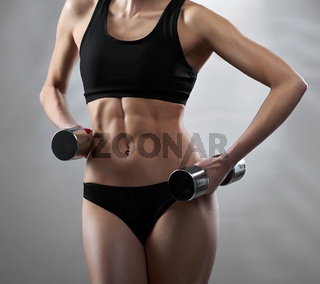 Stunning hot sexy body of a young fitness woman