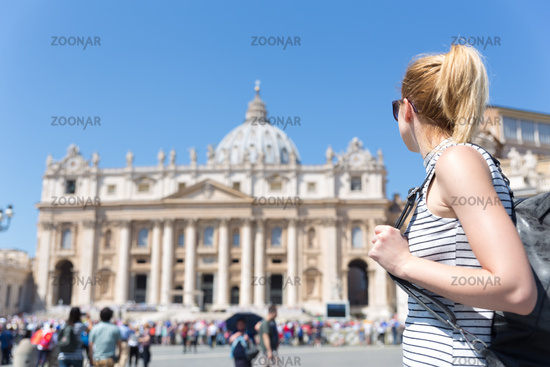 Woman on St. Peter's Square in Vatican in front of St. Peter's Basilica.