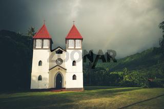 Rainbow on Haapiti church in Moorea island, landscape