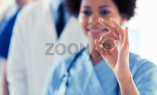 close up of doctor or nurse showing ok sign