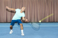 Tennis player with passive forehand game.