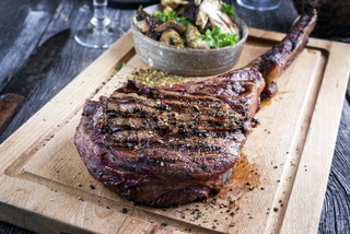 Barbecue Tomahawk Steak on Cutting Board