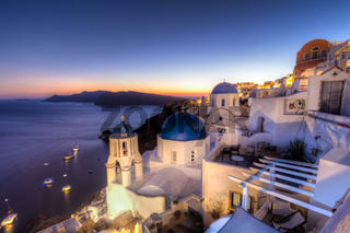 Traditional greek village of Oia at dusk, Santorini island, Greece.