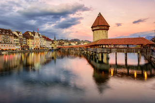 Wooden Chapel Bridge and Water Tower on sunset, Lucerne, Switzerland