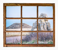 prairie with rocks and butte window view