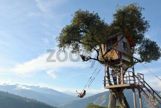 The Swing At The End Of The World Located At Casa Del Arbol, The Tree House In Banos De Aqua Santa, Ecuador, South America