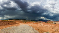 Ominous Stormy Sky and Cumulus Clouds with Rain in the Desert