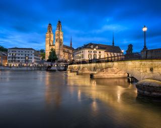Grossmunster Church and Limmat River in the Evening, Zurich, Switzerland