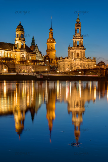 The towers of Dresden at dawn reflecting in the River Elbe