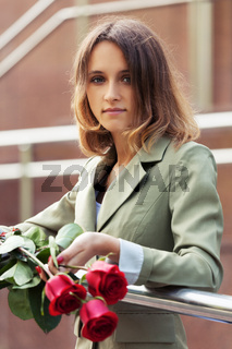 Young fashion woman with red roses