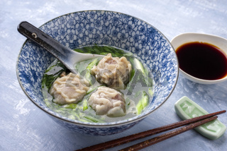 Traditional Chinese Wan Tan Soup as close-up in a bowl