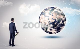 Man looking at earth globe, courtesy of NASA
