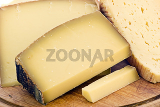Mountain cheese colletion as closeup on a chopping board