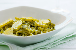 Closeup of linguine pasta with pesto genovese and potatoes