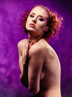 Beautiful young red-haired woman topless with a bright make-up