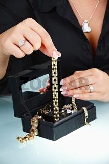 Female hand holding bracelet