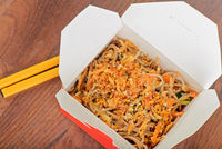 Meat and noodles in take away container