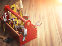 Support service concept. Toolbox with tools on wooden background. Construction.