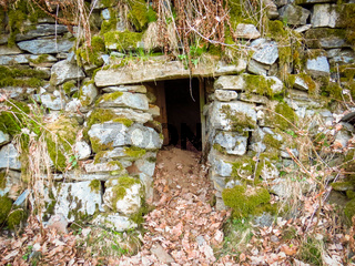 Entrance to an old abandoned stone cellar in Tvedestrand, Norway