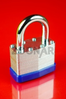 Security padlocks isolated against a red background