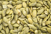 raw pumpkin seeds background