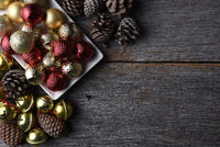 Christmas ornaments and decorations on a rustic wood table with copy space.
