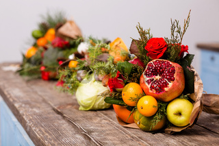 Colorful winter bouquets of fruits and vegetables.