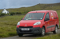 Royal Mail service car on duty in the Scottish Highlands, Sutherland, Scotland, Great Britain