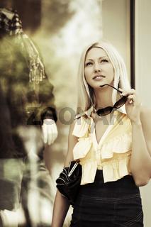 Fashion woman at the mall window