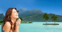 happy woman enjoying sun on bora bora beach