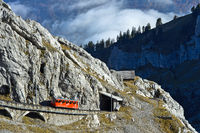 Red railcar of the Pilatus Railway in a steep passage in the Pilatus massif, Alpnachstad,Switzerland