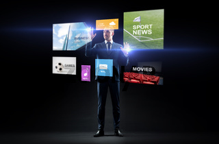 businessman with applications on virtual screen