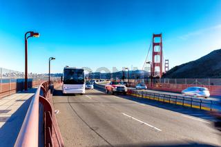 traffic on landmark bridge in blue sky