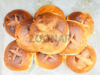 Pumpkin seed buns on baking paper sfter baking at close-up in a nicely put pile
