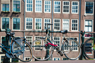Bicycles on the bridge in Amsterdam, Netherlands