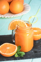 Orange fresh juice in a mason jar
