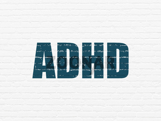 Healthcare concept: ADHD on wall background