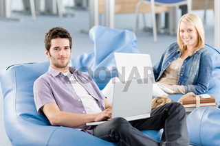Young students at high-school working on laptop