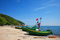 Fishing boats moored on sandy beach at Baltic Sea in city of Gdynia