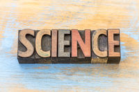science word abstract in wood type