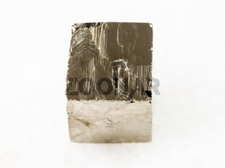 rough pyrite crystal on white marble