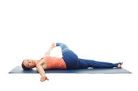 Woman doing Yoga asana Revolved knee-to-chest Pose isolated