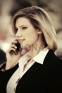 Young fashion business woman calling on cell phone outdoor